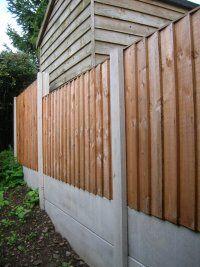 Merbau screen with metal matrix fence extender 3 gardens for Garden decking north london