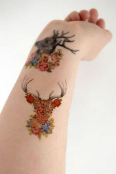 Floral deer tattoo on the arm