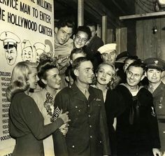Lana Turner, Deanna Durbin and Marlene Dietrich welcome the millionth visitor to the Hollywood Canteen, 1944