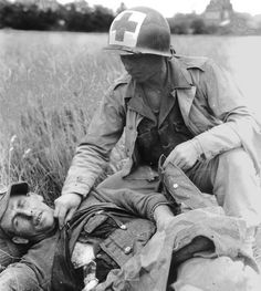 """A medic of the 26th Infantry Regiment, 1st Infantry Division in Normandy, France - July 1944 """""""
