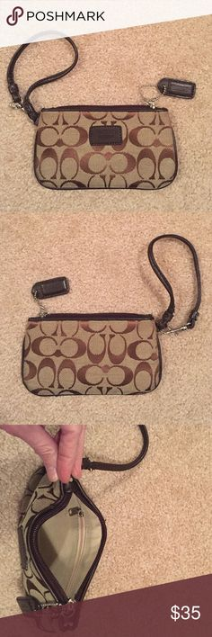 Brown and khaki Coach signature wristlet Excellent condition. 7 inches x 4 inches. Zippered pocket inside. Coach Bags Clutches & Wristlets