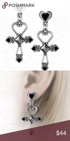 "Egyptian Ankh Heart Earrings Egyptian Ankh Earrings - Alchemy Gothic Amourankh An elemental symbol of everlasting love, combining the all-pervasive heart with the ancient Egyptian Ankh, symbol of everlasting life. This pair of delicate, pewter scroll work ankh-heart earrings have 6mm crystal/enamel details and are suspended from black enameled heart studs. Mounted on surgical steel posts. Approximate Dimensions: Width 0.91"" x Height 1.85"" x Depth 0.12."" Materials: Fine English Pewter with…"