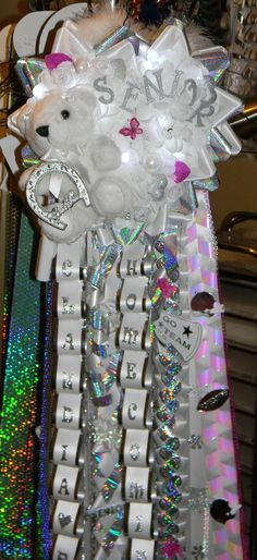 Like the opal event colors of the ribbon.  Would be great with hold and silver.  Senior Lighted Triple Homecoming Mumu