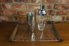 Google Image Result for http://i.ebayimg.com/t/Vtg-50s-60s-Retro-Bar-Art-Deco-Atomic-Era-Glass-Cocktail-Drinks-Serving-Tray-/00/s/MTA2NFgxNj...