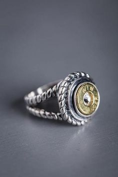 This rope silver bullet ring features detailed jewelry metalwork of twisted silver threads to form a rope band as the support to the 9mm bullet casing ring. #bourbonandboots #madeinthsouth #southernliving #southernstuff #southerngifts #valentinesgiftforher #valentinesday #forher #jewelry #southernjewelry #ring