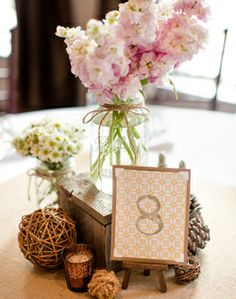reception decor- jars, flowers, table number