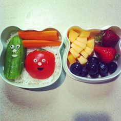 VeggieTales bento: rice, Larry the Cucumber, Bob the tomato, carrots, tomatoes, cantaloupe, strawberries, grapes