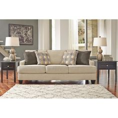 This contemporary sofa comes with 4 accent pillows and features track arm styling and wedge feet. (Matching Loveseat also available.) Brielyn Sofa | Weekends Only Furniture and Mattress