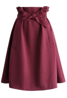 Step out for a night on the town wearing our Sassy Tie-Bow midi skirt in this rich, sophisticated burgundy hue just perfect for the fall! Style with a crop top and add a leather jacket for a little more edge or go with a soft sweater!  - Concealed side zipper closure - Wait tie with belt loops - Slanted side pockets - 100% Polyester - Machine washable  Size(cm) Length Waist XS       61     64 S &nbs...