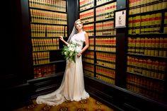 A #striking #portrait of the #bride #beforethewedding with these #encyclopedias in the #library! :Laura + Dan's fantastic art deco wedding in Sacramento, California:: #artdecobride #bridalportrait #bridalfashion #Pronovias