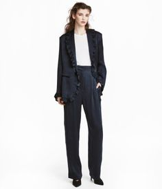 Dark blue. Suit pants in lightly crinkled woven fabric made from a cupro and viscose blend. High waist with pleats. Side pockets, mock back pockets, and