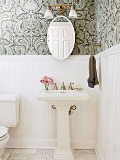 I saw a similar-looking wall treatment on a design show that used a giant stencil and a lighter colored paint to get a similar effect.  Or is it affect? :)
