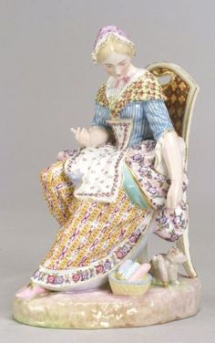 Meissen Porcelain Figurine of a Woman with a Cat late 19th century