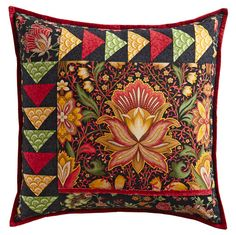 For a quick home décor project, use Flying Geese units to frame a fussy-cut large floral motif and assemble the unit into a pillow.