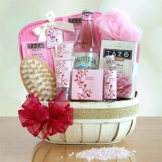"""A perfect Valentine spa gift!    Includes:    2-ounce bottles of fragrant cherry blossom body lotion  Invigorating body scrub  Luxurious hand lotion  Shower gel  Bath salts  A pink body sponge  Wooden massager  Bubbly Calistoga water  A box of Tazo """"Rest"""" tea"""