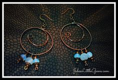 Copper wire wrapped hooped earrings with mother of pearl and moonstone beads.