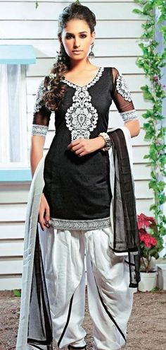 Check out the funky tux stripe on the salwar... vintage is definitely back! $53.62