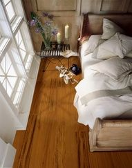 Armstrong engineered flooring in Tigerwood for a romantic look in your bedroom