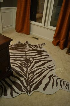 Faux zebra hide rug made from drop cloth. Tutorial @ www.whatsurhomestory.com