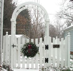 Pretty gate design for garden fence