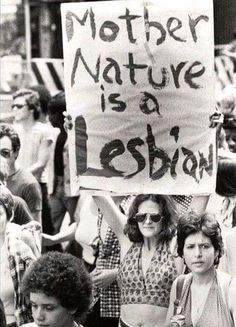 """""""Mother Nature is a Lesbian,"""" Christopher Street Liberation Day Parade, New York City, June Photo by Bettye Lane. Hippie Life, Hippie Art, Kombi Hippie, Mundo Hippie, Liberation Day, Vintage Lesbian, Lgbt History, 70s Aesthetic, Protest Signs"""