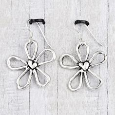 Blossom earrings with a romantic heart in the center   #earrings #cowgirl #jewelry #cowgirljewelry  http://www.islandcowgirl.com/