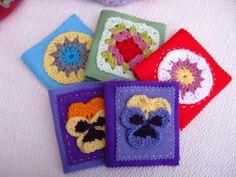 Felt needle cases embellished with crochet.
