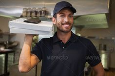 Smiling pizza delivery man holding two pizza boxes in a commercial kitchen ... 20s, Commercial Kitchen, Looking At Camera, Pizza Box, Pizza Delivery Person, attractive, baseball cap, catering building, cheerful, food and drink, handsome, happy, hispanic, holding, hotel, indoors, job, kitchen, male, man, occupation, portrait, profession, professional, restaurant, smiling, standing, t-shirt, uniform, young adult