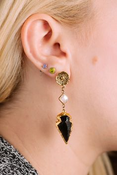 Talk about cutting edge...  Black obsidian arrowheads with diamond-shaped moonstone cabochons dangle from 22-kt vermeil posts. #crystal #druzy #rawcrystal #gemstone #earrings #dropearrings #jewelry #sparkle #fashiondiaries #fashion