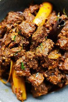 Rendang (The BEST Recipe) - Rasa Malaysia Beef Rendang - the best and most authentic beef rendang recipe you will find online! Spicy, rich and creamy Malaysian/Indonesian beef stew made with beef, spices and coconut milk Beef Rendang Slow Cooker, Beef Rendang Recipe, Slow Cooker Beef, Meatloaf Recipes, Meat Recipes, Indian Food Recipes, Asian Recipes, Cooking Recipes, Indonesian Recipes