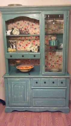 I took my old china cabinet painted it and distressed it all for about $20! I love it!