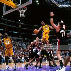 Kobe Bryant #8 of the Los Angeles Lakers shoots the ball against the Portland Trail Blazers on December 3, 2000 at Staples Center in Los Angeles, CA.