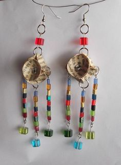 Book Bead Earrings by Erratic.Chromatic; any paper would work (scrapbook, magazines, cards, wrapping paper, etc.)