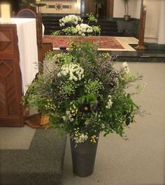 Vintage Antique Alter Arrangement with China Aster, Queen Anns Lace, Hypericum Berries and a variety of greens by Floral Accents