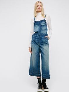 Saya Overall | Made from a super soft and luxe premium denim, these overalls feature distressed and whiskering detailing with ankle grazing wide legs and a released hem.  Four-pocket style with adjustable straps. American made.