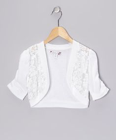 Add a layer of cozy sophistication to any ensemble with this lacy shrug. A soft cotton blend means this wardrobe-booster is as comfy as it is charming.Body: 60% cotton / 40% polyesterContrast: 100% cottonHand wash; dry flatImported