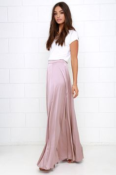 Take a twirl in the Parasol Spin Mauve Satin Maxi Skirt, and captivate an entire crowd! Woven satin fabric, in a lovely mauve hue, creates a high banded waist that fastens at the hip with a hidden zipper and clasp. A full and eye-catching skirt descends to a maxi-length hem. Unlined. 97% Polyester, 3% Spandex. Hand Wash Cold.