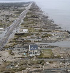 Hurricane Ike 2008 left one house standing in Gilchrist, TX - nothing else as far as you can see. Used to be solid beachfront !! ( Amazing why ONE only house is completely untouched while ALL the other identical houses succumbed to this violent hurricane !!! )