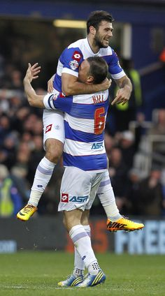 Clint Hill sniffs Charlie Austin as QPR celebrates Austin's goal v Charlton