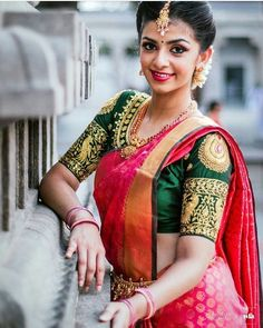 South Indian bride. Gold Indian bridal jewelry.Temple jewelry. Jhumkis.Red silk kanchipuram sari with contrast green blouse.Braid with fresh jasmine flowers. Tamil bride. Telugu bride. Kannada bride. Hindu bride. Malayalee bride.Kerala bride.South Indian wedding. Pinterest: @deepa8