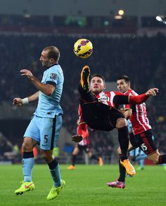 Sunderland player Connor Wickham clears the ball despite the attentions of Pablo Zabaleta during the Barclays Premier League match between Sunderland and Manchester City at Stadium of Light on December 3, 2014 in Sunderland, England.
