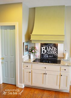 Love the addition of color to this kitchen - painted pantry door and hood.