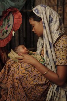 India, this mother looks at her child with love like every other mother in the world. This show you that God made all of us with a maternal loving heart, no matter what country, race, religion or culture.