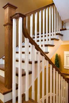 Distinctive Interiors - Dark Oak sets off the white spindles and risers on these custom built stairs