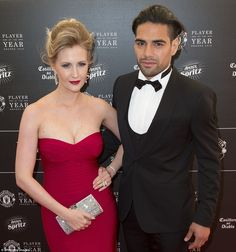 Colombian striker Radamel Falcao poses for the cameras with wife Lorelei as he arrives at the Manchester United end-of-season awards do