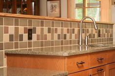 Completed custom home interior, granite countertops with tile backsplash. Louden Ridge, Saratoga Springs, NY