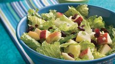 Crunchy apple and chewy dried cranberries bring a bit of sweetness to an ordinary green salad.