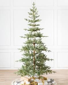 Measuring feet tall and 38 inches wide, the Alpine Balsam Fir is composed of sparse 448 branch tips. This highly realistic artificial Christmas tree features a visible faux trunk and a narrow shape with green needles made from PE True Needle foliage (