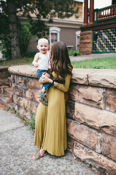 The perfect fall look for mom and toddler. Obsessed with that mustard maxi dress and loving the tank top and skinny jeans on the little boy.