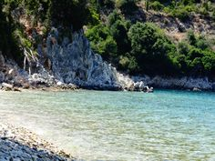 Plakoutses is a quiet and isolated beach in Kioni, Ithaca, with blue waters and olive trees that reach the sea. Greek Islands, Greece Travel, Photo S, Beaches, Travelling, Beautiful Places, Trees, Swimming, Sea